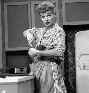 I Love Lucy wearing an apron