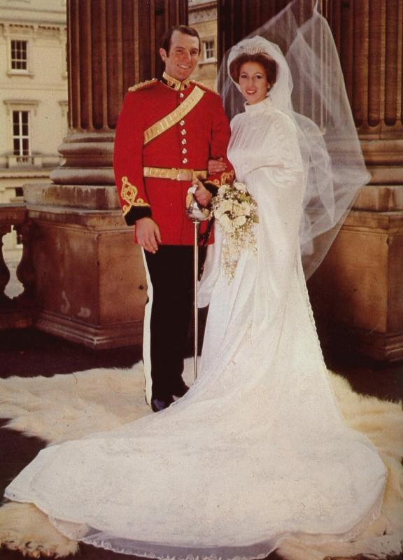 Princess Anne of Great Britain wears a modest high-neck wedding dress