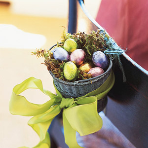 basket with chocolate candies and green bow