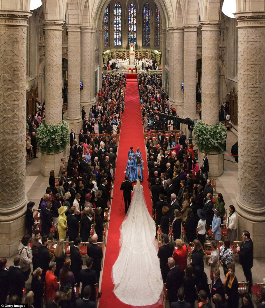 Princess Stephanie of Luxembourg walks down the aisle with her brother Count Jehan de Lannoy