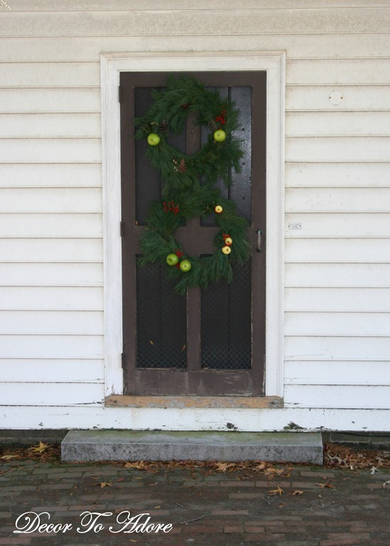 two wreaths on one door
