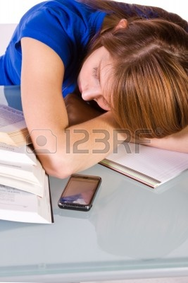 College Student Falling Asleep while Studying for her Finals - Isolated Background Stock Photo - 6802628