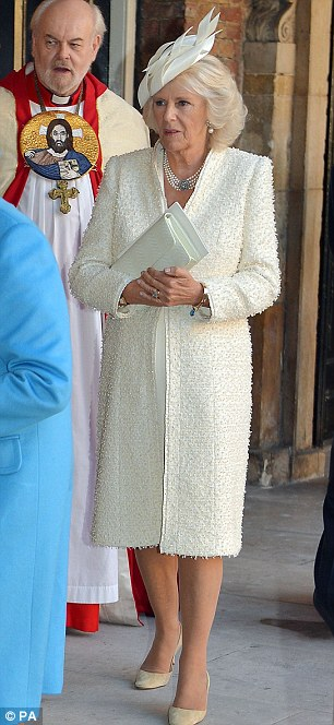 Elegant: New grandmother Camilla looked wonderful in a chic cream coat, pearl necklace and neat clutch bag