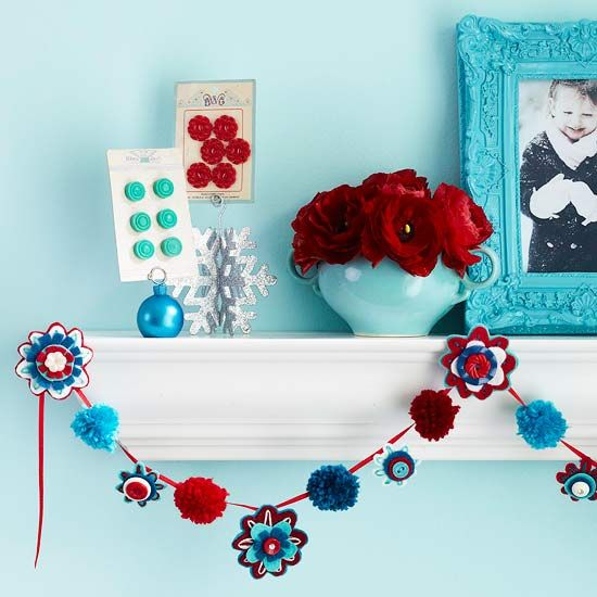 Pom-Pom and Flower Garland: Fashion a swag with flower power by stringing button-capped flowers and old-time yarn pom-poms together. Hang the swag from a shelf or window to highlight its puffed-up blooms. http://www.bhg.com/christmas/crafts/daisy-felt-garland/