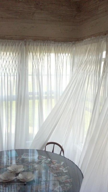 White Organdy Smocked Curtains  These fabulous curtain panels of sheer white organdy are beautifully hand smocked across the top. They add a soft and dramatic flair to any room in addition to letting in natural light while maintaining privacy. I have them all through out my house, I simply adore seeing them blow in the breeze, magical.