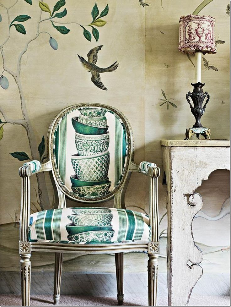 Play with patterns & prints. Nicky Haslam ~ dining room chair is covered with Pierre Frey's Ming Green, which Haslam sprayed with tea to soften its whites. What looks like wallpaper is actually a hand-painted replica - complete with seams & torn edges - of the paper John Fowler put up that was too ragged to keep.