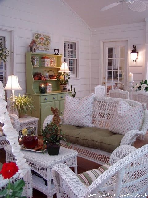 Screened-In Porch with Sheer Curtains and White Wicker