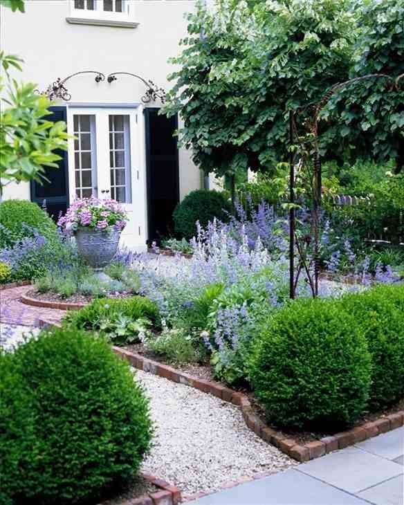Pathway through defined planting borders to front door, something along these lines could be nice...