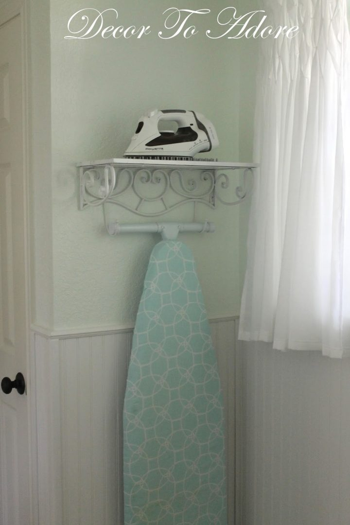 A Pretty Storage Solution For An Iron And Ironing Board