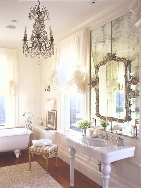 I know you want to keep the large mirror in your powder room...so lets hang a decorative one over the top.