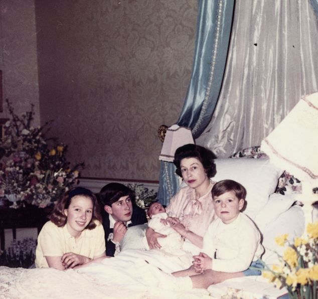The Queen in bed after the birth of Prince Edward in 1964 surrounded by her other children, Prince Charles of Wales, 15, Prince Andrew, 4, and Princess Anne, Princess Royal, 13.: