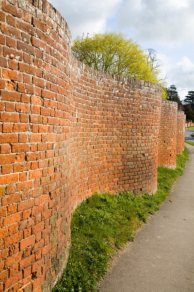 Red brick crinkle crankle or serpentine wall at Easton, Suffolk, England:
