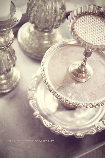 Diy for all those random silver plates, with silver candlesticks.. works for me!!: