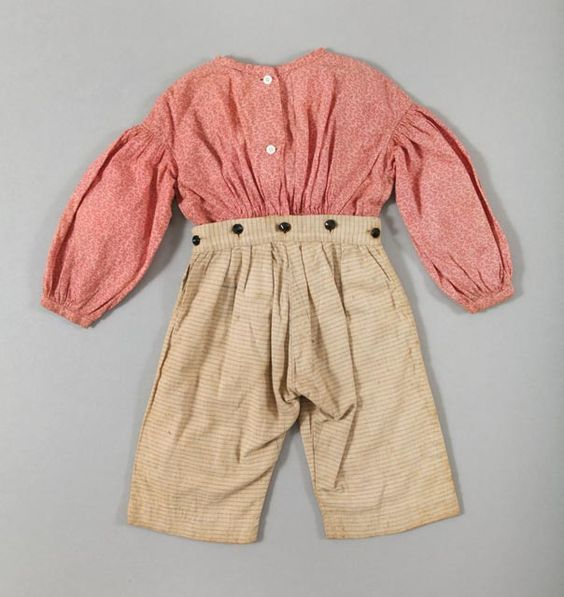 Boy's outfit, pink and red calico shirt attached to plaid tan blue and gray patterned pants, hand-sewn, cotton and wooden buttons, circa 1840.: