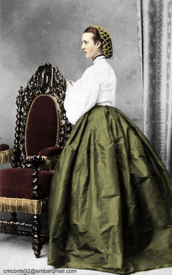 This photo of Princess Alexandra of Denmark shows an early 1860s chemisette with pagoda sleeves; she wears a hairnet:
