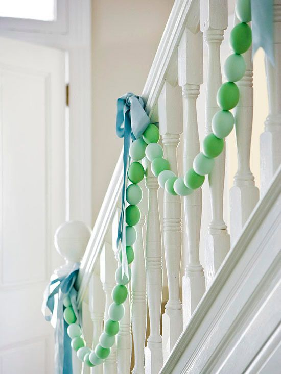 Decorate a staircase, mantel or table with an Easter egg garland. How-To: http://www.bhg.com/holidays/easter/decorating/decorate-with-easter-eggs/#page=7: