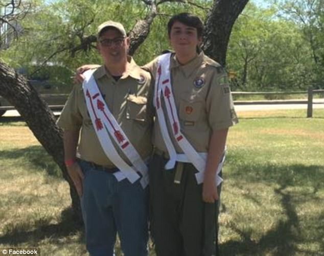 Reid's father, John Comita, pictured here on the left, has spoken of his heartbreak at losing his son but says he does not blame the scouting colleagues that his son was with at the time