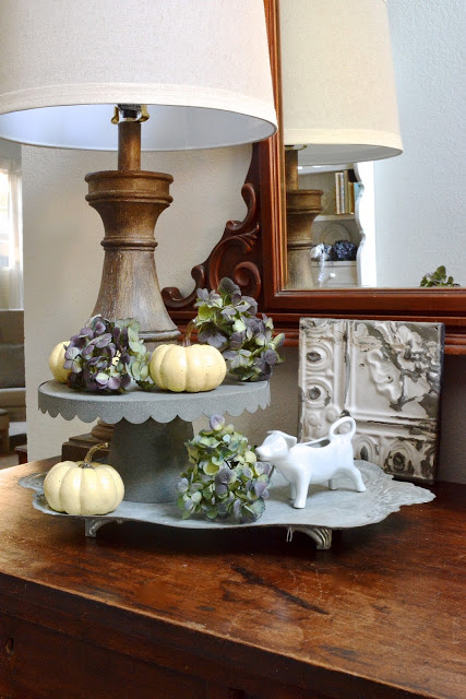 Tiered fall display with hydrangeas and baby boos