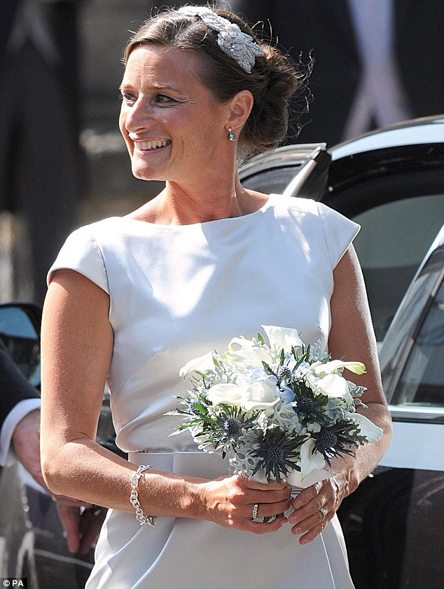 And the bidesmai's looked good too: Maid of Honour Dolly Maude looked pristine with her elegant up-do and neat dress