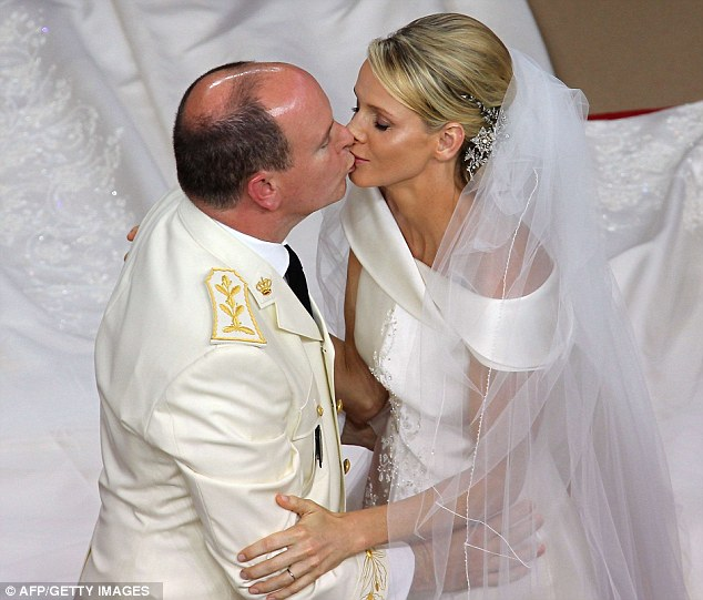 The new Princess Charlene shares a kiss with her Prince after they are pronounced husband and wife