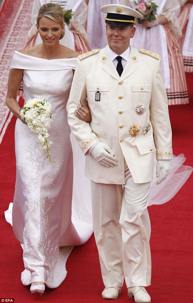 The bride wore a striking Armani gown for the religious service in the palace courtyard earlier on Saturday
