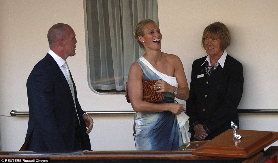 Zara Phillips laughs as she enjoys a cocktail party on board the Royal Yacht Britannia