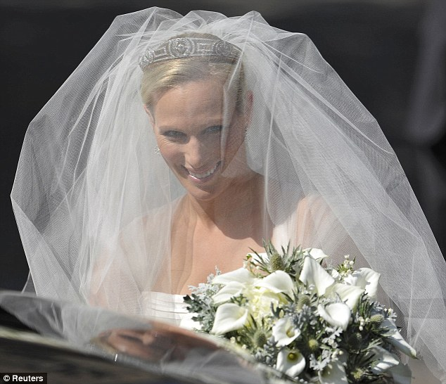 Beautiful: Zara had a silk veil over her face, and a pretty diamond tiara on her head