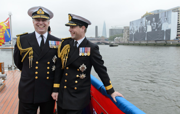 (L-R) Prince Andrew, Duke of York and Prince Edward, Earl of Wessex laugh together on the deck of the boat 'Havengore' as it passes a large picture of the British royal family during the Diamond Jubilee Thames River Pageant on June 3, 2012 in London, England. For only the second time in its history the UK celebrates the Diamond Jubilee of a monarch. Her Majesty Queen Elizabeth II celebrates the 60th anniversary of her ascension to the throne. Thousands of well-wishers from around the world have flocked to London to witness the spectacle of the weekend's celebrations. The Queen along with all members of the royal family will participate in a River Pageant with a flotilla of a 1,000 boats accompanying them down the Thames.