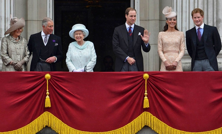 The Queen smiles as she stands on the balcony of Buckingham Palace with the Duchess of Cornwall, Prince Charles, Prince William, the Duchess of Cambridge and Prince Harry