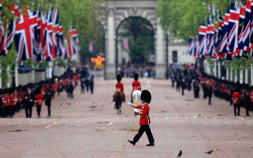 A guardsman marches across The Mall