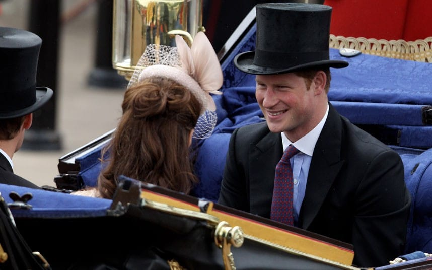 Prince Harry smiles during the Diamond Jubilee carriage procession on The Mall
