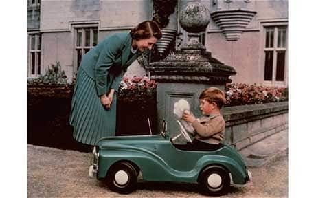 A young Prince Charles plays with his toy car