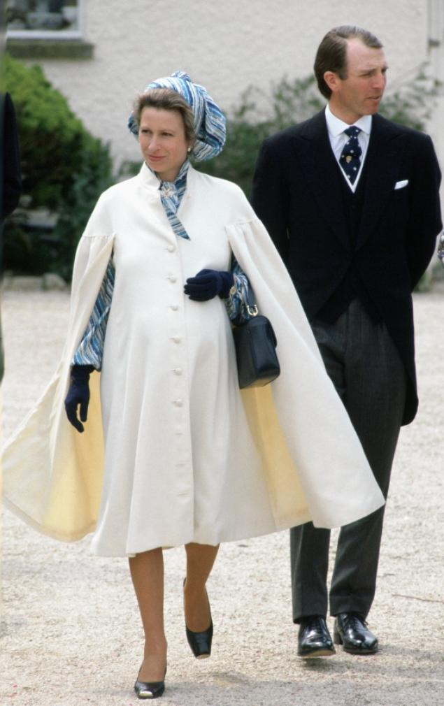 Princess Anne appeared radiant in this timeless ensemble while pregnant with her second child, Zara Phillips. While attending a spring wedding just weeks ahead of her due date in 1981, the pregnant royal donned a timeless, cream-colored cape that complemented her blue and white printed dress underneath. She pulled the rest of her look together with a matching head scarf, black leather handbag and a delicate pair of gloves.