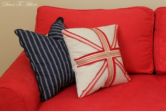 A dyed red slipcover couch