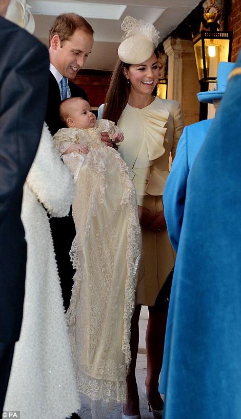 Queen Elizabeth II speaks with the Duke and Duchess of Cambridge