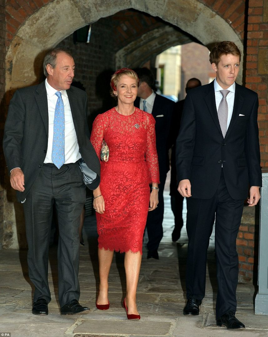 Prince George's godparents Julia Samuel and Hugh Grosvenor are pictured arriving with The Hon. Mrs Samuel's husband, Michael, left