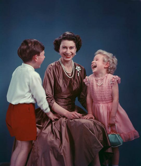 The Queen with Prince Charles and Princess Anne chuckling ~ 1954