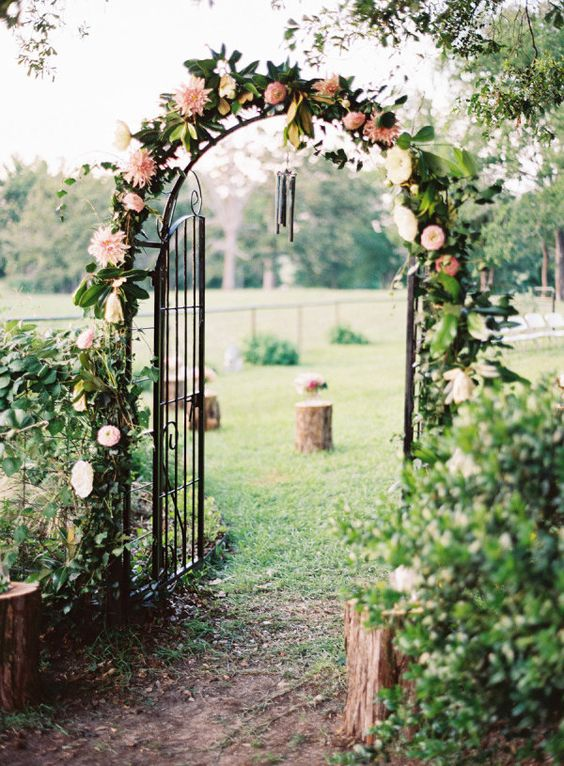 Secret garden inspired ceremony arch: http://www.stylemepretty.com/2016/03/02/ceremony-decor-thatll-have-you-saying-i-do/: