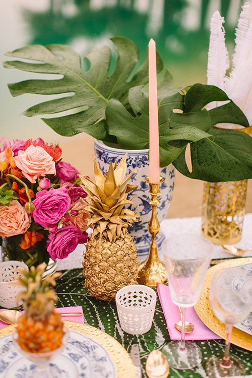 Paint pineapples gold for table decorations | Brides.com: