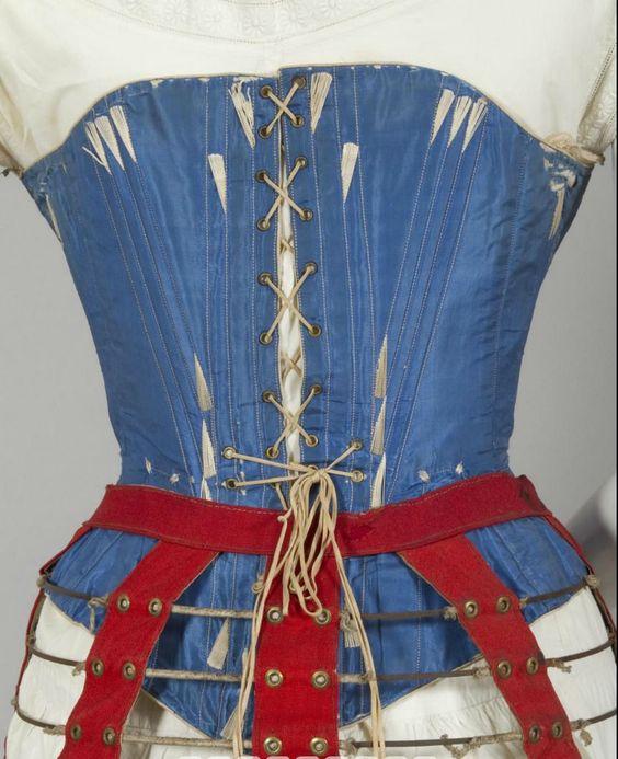 1860s blue silk corset. Steel bones and busk, brass hardware, cream cotton