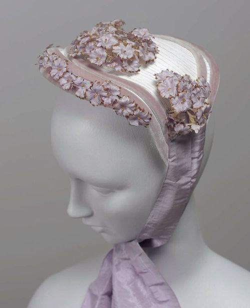 Bonnet Made Of White Straw, Designed To Be Worn On Top Of The Head, Trimmed