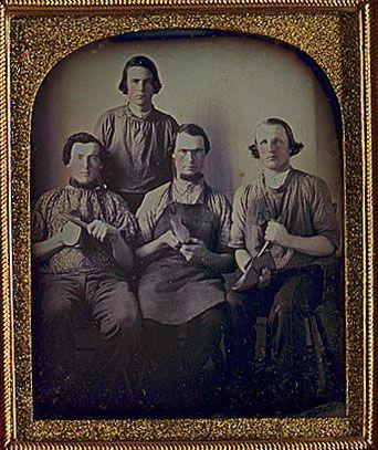 Daguerreotype of four shoemakers.