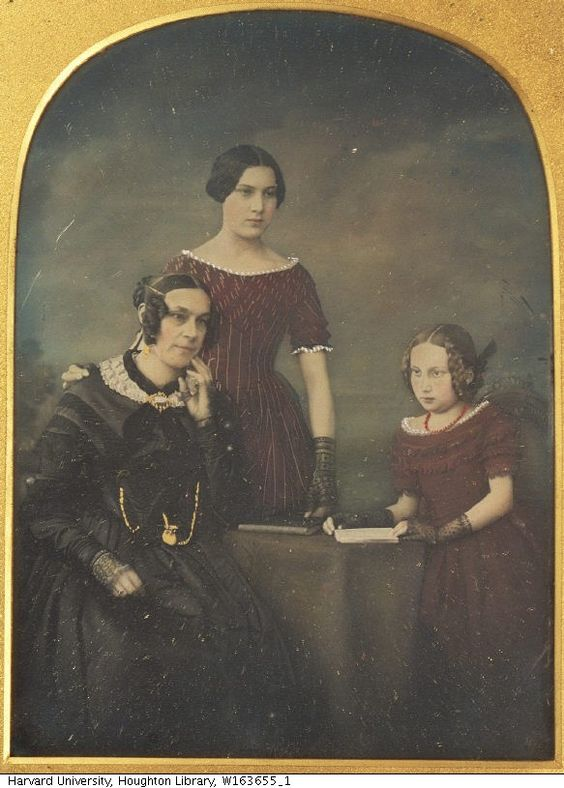 mother and daughters wearing gloves