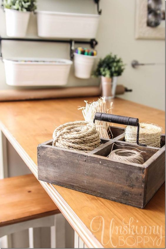 Use an old divided box to store twine in Craft Room.