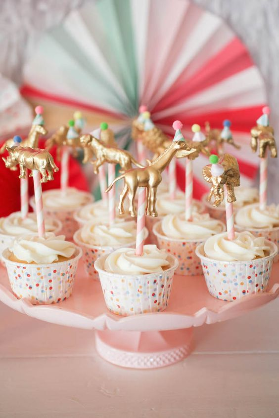 DIY Gold Animal Cupcake Toppers- using craft store animals and gold spray paint.