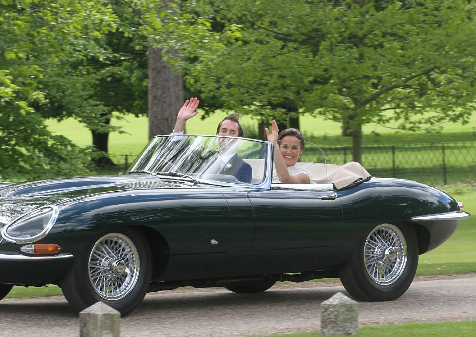 The groom's hair blew in the wind as he drove his new bride home after marrying her at St Mark's Church. Despite rain forecasts, the couple certainly got lucky with the weather