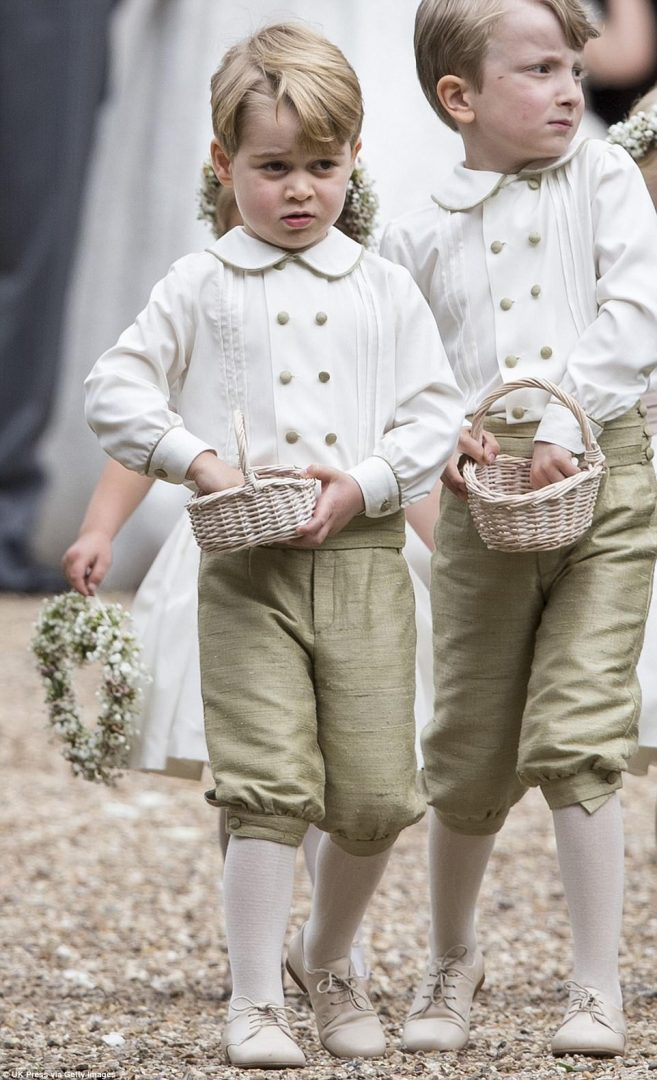 Prince George was cherubic in his little page boy outfit as he gathered some petals to throw over his auntie